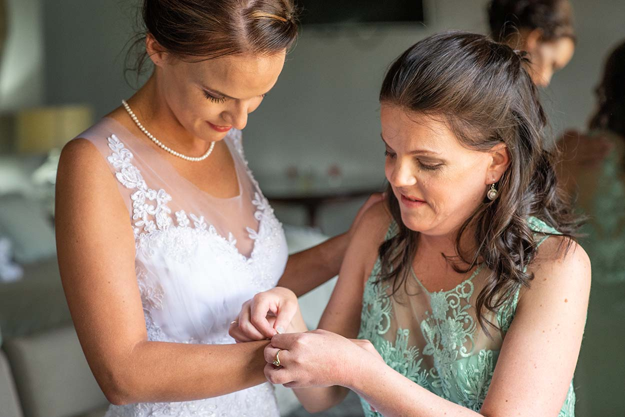 bride and bridesmaids getting ready Wedding Photos by Mudboots Photography at Leopard and Lace in Bloemfontein