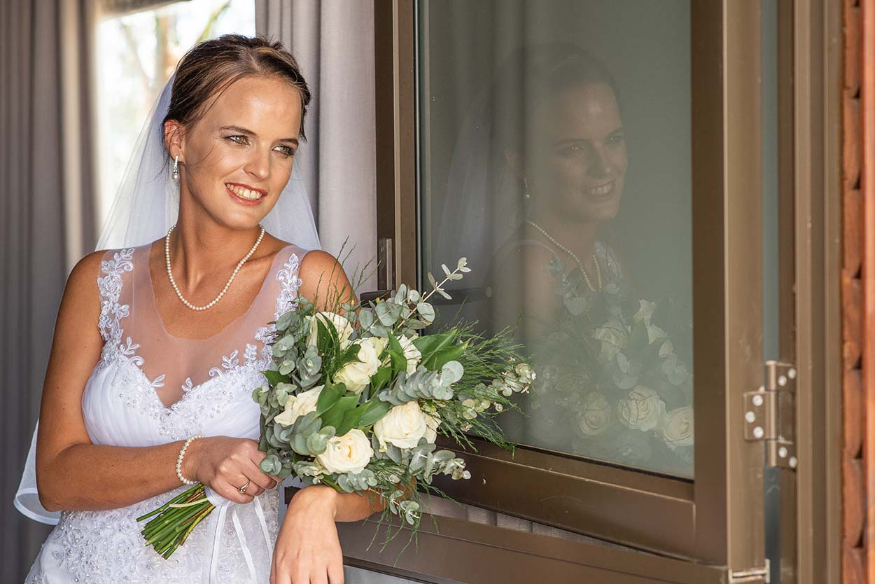 bride flowers in hand Wedding Photos by Mudboots Photography at Leopard and Lace in Bloemfontein