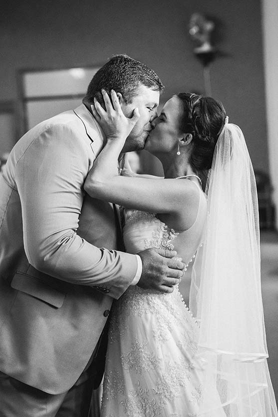 Church kiss Wedding Photos by Mudboots Photography at Leopard and Lace in Bloemfontein