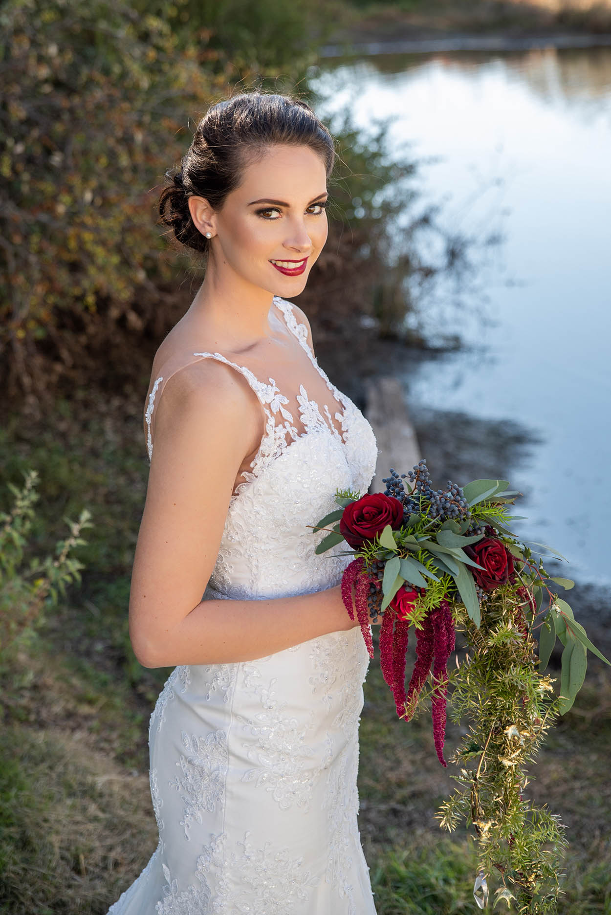 wedding photo by Mudboots at Monte Bello Estate Bloemfontein bride with flowers red lips