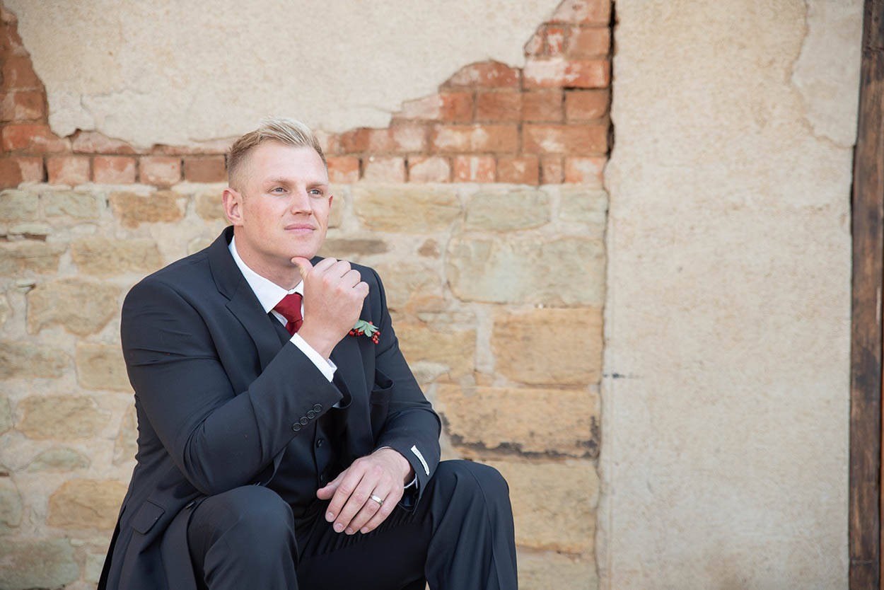 wedding photo by Mudboots at Monte Bello Estate Bloemfontein groom with burgandy tie