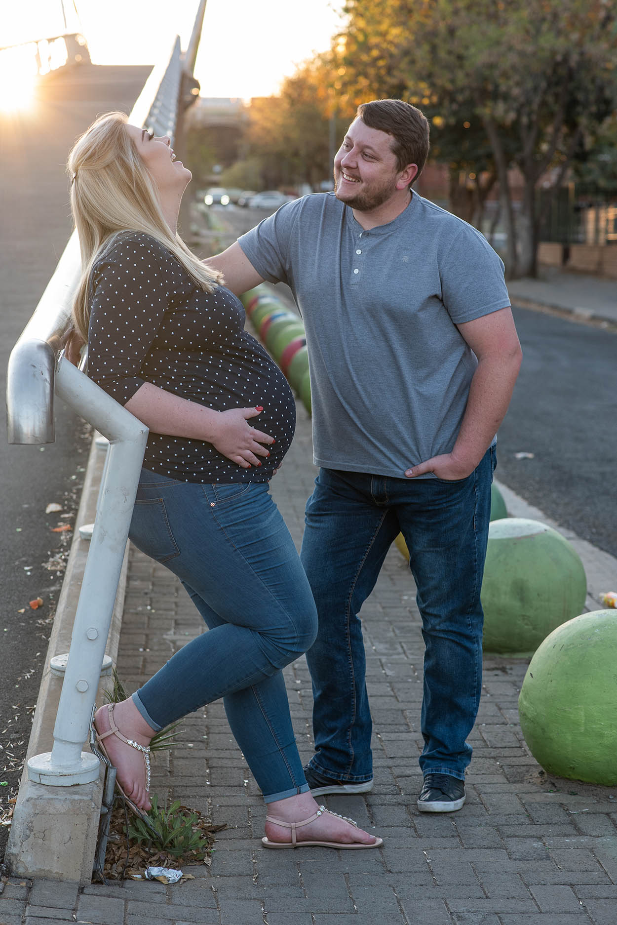 Maternity photos by Mudboots Photography couple wearing denim in Bloemfontein city urban