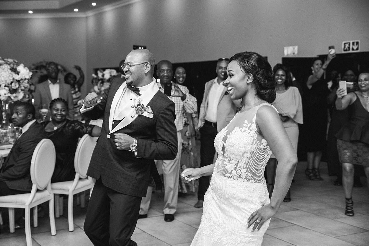 entering fun dancing Wedding at Imvelo Safari Lodge Bloemfontein pink and blue theme photography by Mudboots wedding and event photography