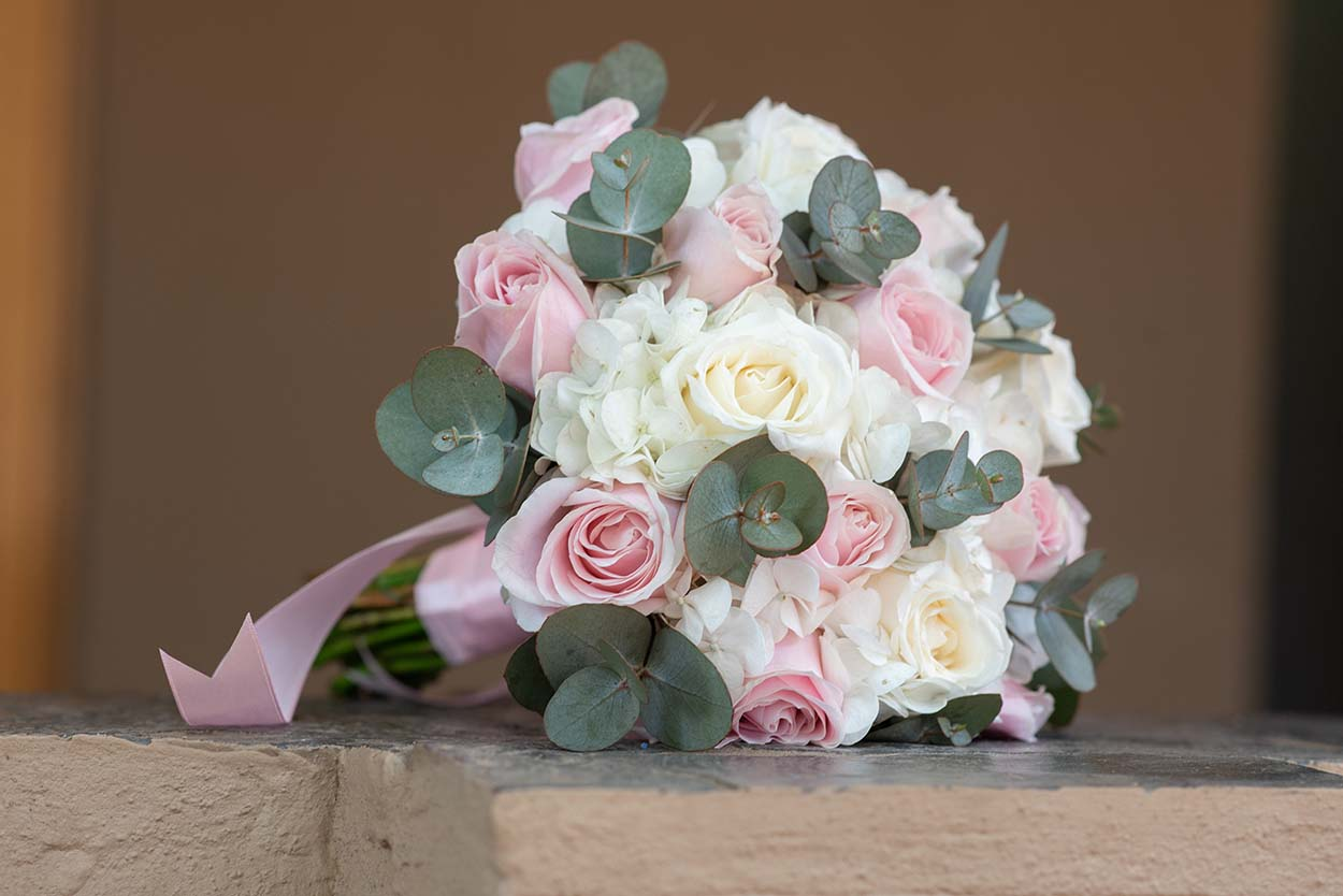 pink and white roses with hydrangea wedding bouquest photo by mudboots photography