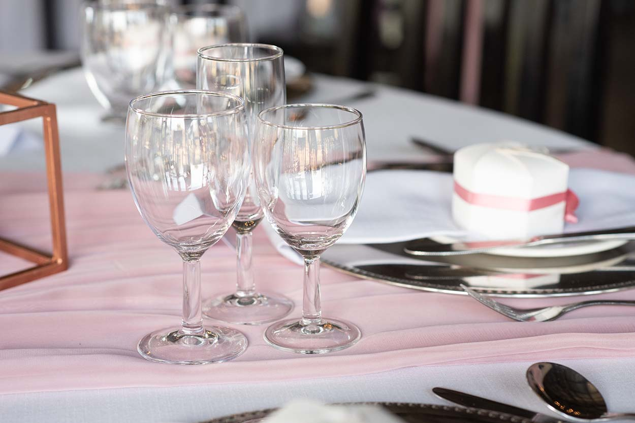 glasses on table tres jolie wedding venue